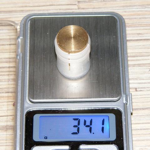 Латунная пуля Рубейкина 12-го калибра массой 34 грамма.